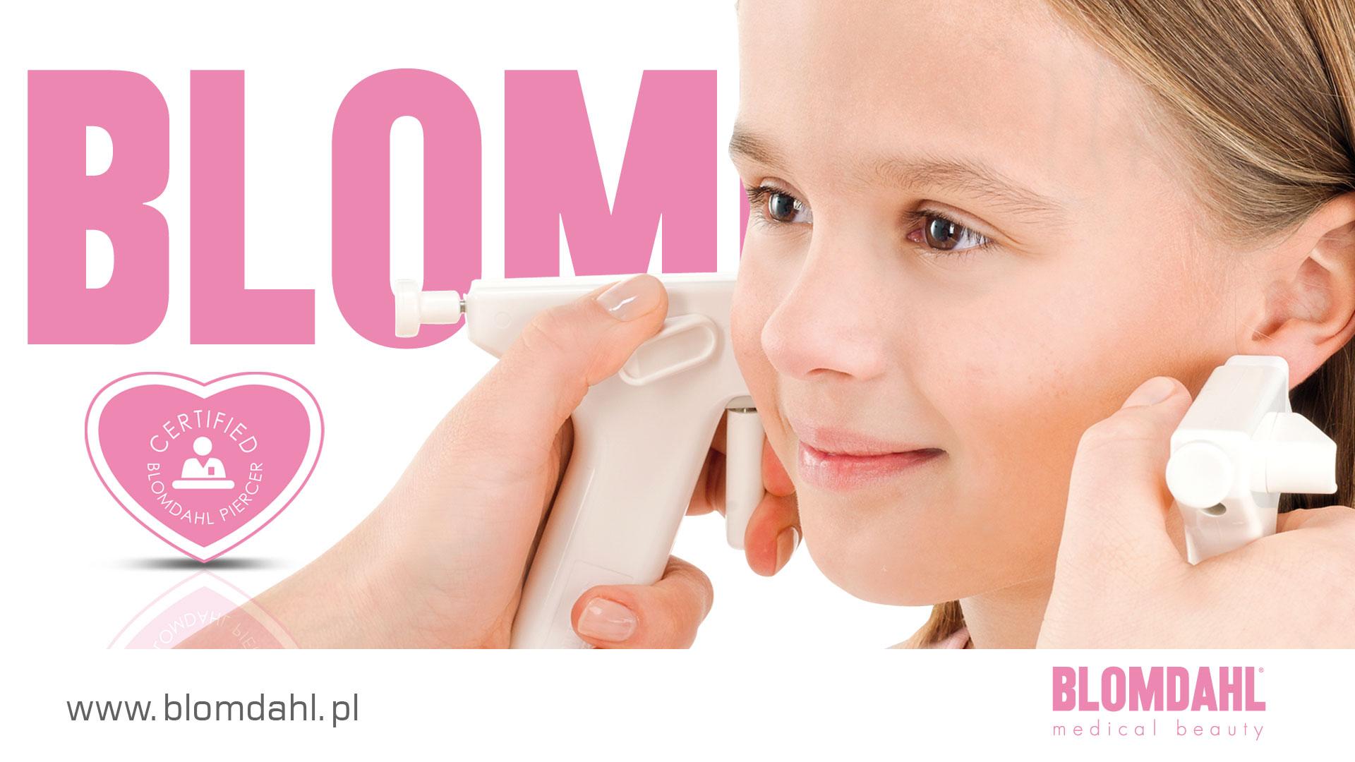 Przekłuwanie uszu u dziewczynki